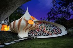 Creative, Colorful and Curved Spiral Shell House Design= I like this one for the stain glass wall
