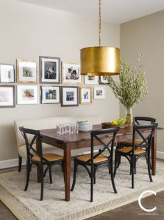Celebrity home interiors - Steph and Ayesha Curry's Nor Cal home featuring a breakfast nook with gold drum shade chandelier, cane style black chairs, upholstered bench and a gallery of cherished family photos.