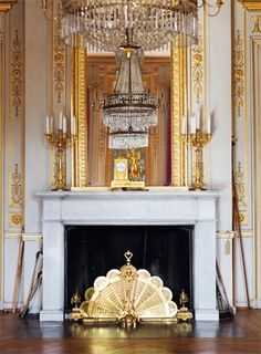 vignette fireplace gold and chandelier