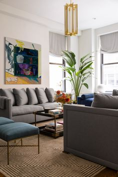 Thanks to a Jewel-Toned Palette and Nuanced Light Layering, This Apartment in NoMad Glows at Night Velvet Upholstered Bed, Custom Canopy, Jewel Tone Colors, Jewel Tones, Manhattan Apartment, Mid Century Dining, Dark Walls, Small Space Living, Dining Table Chairs