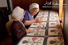 The quilters apprentice a young girl holds scissors as her mother places a stich in an intricate quilt. ~ Sarah's Country Kitchen ~