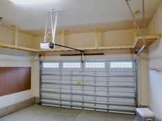 Our Big Shelf - Custom Garage Overhead Storage Installation . We did this with our garage with kayak storage over the cars on a pully system. Diy Garage Storage, Garage Shelving, Garage Shelf, Garage Ceiling Storage, Small Garage Organization, Shelving Ideas, Garage Storage Solutions, Smart Storage, Small Garage Ideas