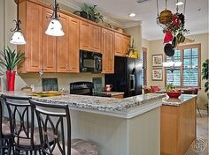 Granite countertop with wood cabinet and vaulted ceiling kitchen