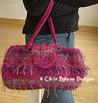 "NaStasha: Start with a basic wool yarn and add any number and type of novelty or accent yarns to create your own fabulous felted bag. The fuchsia color is optional!  Size: 14"" wide x 8"" high x 3"" deep felted  Gauge: 2.5 sts/inch on #13 needles"