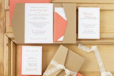 Rustic wedding invitation with woodgrain pocket and lace tie. Sweet monogram design surprise on backs of loose enclosures.