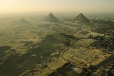 National Geographic: Aerial view of the Pyramids of Giza and excavation site. by National Geographic on artflakes.com as poster or art print $16.63