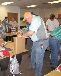 Cutco's branch of Santa's workshop. Engineering and accounting employees are hard at work wrapping gifts for those in need. (scheduled via http://www.tailwindapp.com?utm_source=pinterest&utm_medium=twpin&utm_content=post303825&utm_campaign=scheduler_attribution)