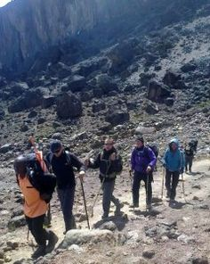 Three Men and a Lady head down to Barranco Camp after lunch at Lava Tower with Private Expeditions