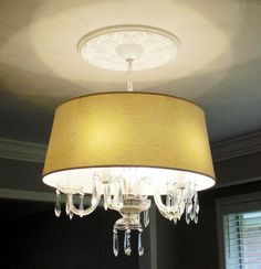 Reader Redesign: A Contemporized Chandelier | Young House Love.  I think this is a terrific way to update a chandelier without painting it.  You could use darker shade with silver or gold leaf interior for even more drama.  It appears to be something that could be done to a rental home chandelier that could be undone when you move!
