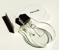 Flat Bulb designed by Korean designer Joonhuyn Kim. It is 1/3 volume of a normal bulb. Its flat shape allows bulbs to be easily stacked and prevents breakage because rolling. I love it! Very cool bulb! Flat Bulb was on display as a part of 100% design tokyo.