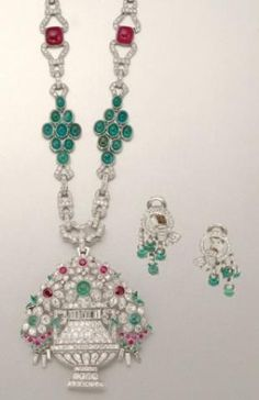 Art Deco Platinum, Diamond, Emerald and Ruby Pendant Necklace and Pair of Earrings for Sale at Auction on Wed, 04/12/2006 - 07:00 - Important Estate Jewelry | Doyle Auction House