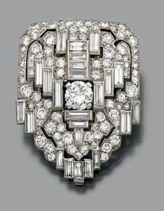 RENE BOIVIN Lapel clip in platinum and white gold, set with openwork crest of brilliant-cut diamonds accented with baguette diamonds and a ...