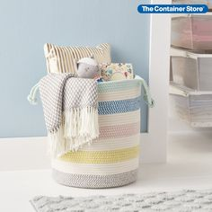 This fresh, fun bin gives you instant storage wherever and whenever you need it. Each cotton basket is made by completely by hand, with a soft look that blends with any room. Use them for magazines, toys, craft projects or throw blankets in a living area or extra towels in the bathroom. Handles on each side make it easy to carry even when full. Stuffed Animal Storage, Nursery Organization, Container Store, Cotton Rope, Throw Blankets, Storage Bins, Living Area, Towels, Magazines