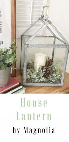 Bring a warm, rustic vibe to your home with the addition of the Galvanized House Lantern Candleholder from Hearth & Hand™ with Magnolia. Handcrafted from durable iron and aluminum with a glass enclosure, this medium-sized, galvanized pillar candleholder features a unique house-shaped frame. Pair with your favorite candle and place it on top of your farmhouse-style side table to give it an extra dose of charm. #affiliate #decor