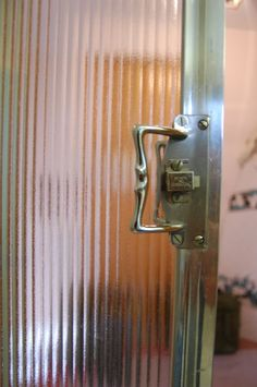 Fluted glass & metal work, possibly for Bath 1 door if it were a slider?