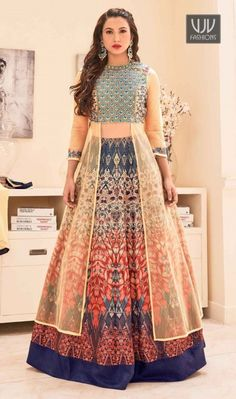 Gauhar Khan Multi Color Silk Designer Choli Lehenga Be an angel and create and establish a smashing effect on everybody by carrying this Gauhar Khan multi color net and banglori silk long choli lehenga. The ethnic embroidered and print work within the dress adds a sign of magnificence statement for your look.