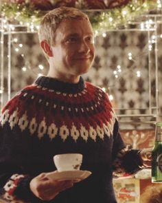 John Watson (Martin Freeman, BBC Sherlock) wearing an ugly Christmas sweater and holding a teacup. There never was a more adorable character! Sherlock John, Sherlock Holmes, Sherlock Fandom, Watson Sherlock, Wooly Jumper, Mrs Hudson, 221b Baker Street, Johnlock, Martin Freeman