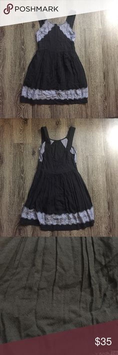 Free people lace trim dress Moderately worn black mini dress with purple lace trim. Skirt is lined and there is a zipper on the side. There is some snagging along the front, but because the dress is black it is not super noticeable. Free People Dresses Mini
