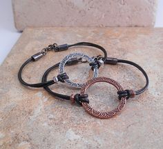 These delicate leather circle bracelets are great for stacking or on their own!   b-129.  $16.  View at: https://www.etsy.com/listing/224153481/stacking-bracelet-copper-bracelet-silver