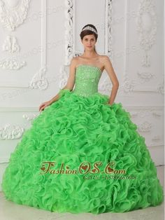Beautiful Green Quinceanera Dress Strapless Organza Beading Ball Gown  http://www.fashionos.com  http://www.facebook.com/quinceaneradress.fashionos.us  Strapless dresses are one of the sexier styles on the market today. They show just enough skin to be classy without beingtoo revealing. The bodice is is accented with scattered crystals and beadings.The full skirt features rolling flowers,which makes the dress very luxurious.