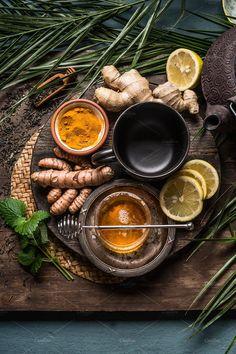Preparation of Turmeric ginger tea and fresh ingredients, top view. Photography Tea, Dark Food Photography, Tea Recipes, Raw Food Recipes, Indian Food Recipes, Turmeric Tea, Ginger Tea, Kraut, Food Styling