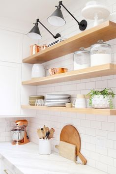 Kitchen remodel ideas for modern farmhouse style Modern Farmhouse kitchen reveal. With the use of paint and open shelving we transformed into a custom space filled with timeless details. Floating Shelves Kitchen, Oak Shelves, Kitchen Shelves, Kitchen Backsplash, Home Decor Kitchen, Kitchen Design, Kitchen Ideas, Kitchen Hacks, White Oak Kitchen