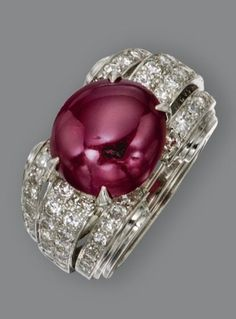 RUBY AND DIAMOND RING, CIRCA 1935 Set with an oval cabochon ruby weighing approximately 7.50 carats, flanked by rows of 48 single-cut and 16 round diamonds weighing approximately 1.10 carats, mounted in platinum, size 3½, numbered 3055. by jlee421