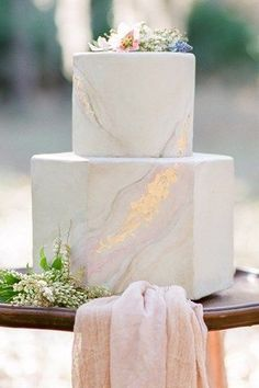 Stone Marble | Marble Wedding Cakes for a Modern Bride. I am obsessed with these marble wedding cakes. They have been having a moment for a while and brides are thrilled to have a marbled wedding cake for their big day. These outstanding cakes come in just about any shade you like. Check out these insanely beautiful marble wedding cake ideas perfect for the modern bride! #weddings #weddingcakes #marblecakes
