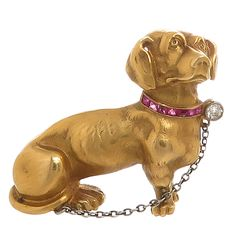 Gem Set and Yellow Gold Dachshund Dog Brooch | From a unique collection of vintage brooches at https://www.1stdibs.com/jewelry/brooches/brooches/
