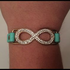 Tiffany blue infinity bracelet Infinity bracelet with Tiffany blue leather straps and a pull bead tighten. Charming Charlie Jewelry Bracelets