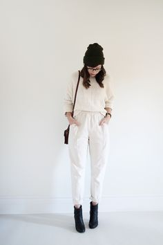 white trousers, white pullover, black ankle boots