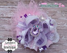 A Beautiful Over the Top *OTT* Sofia the First Inspired Hair Bow with Rhinestone Center and Ostrich Feather Accents on Etsy, $22.00