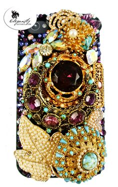 very unique and striking iPhone case handcrafted with purple Swarovskis and gold and turquoise elements. It was sold before it was even finished. Luxuriously luscious, it is now floating around NYC!     To get your own one-of-a-kind case visit www.elegantlyUntamed.com/Showroom