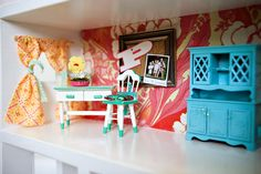 I love the turqoise armoire in this dollhouse.  We need bright colors in our dollhouse.