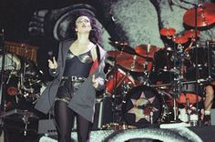 Siouxsie Sioux leads the Banshees through their Lollpalooza performance in 1991 at the World Music Theater in Tinley Park. (Jon Sall/Sun-Times)