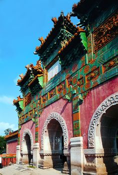 """The glazed archway of the Putuozongsheng Monastery. Three bays wide and four columns deep with seven towers, this is the place where Bodhisattva performed Buddhist rites to save the souls of the dead. From """"Buddhist Buildings,"""" a volume of the Library of Ancient Chinese Architecture."""