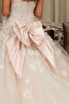 Bow wedding gown.. A pale pale pink wedding dress