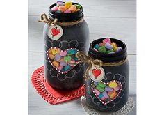 Super cute DIY Valentine gift.  Chalkboard Mason Jars filled with candy hearts. #ValentinesDay #MasonJars