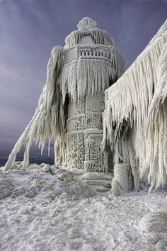 A lighthouse stands frozen still after a big storm in St Joseph, Michigan. //I love the look of the ice encasing the lighthouse EL// Lac Michigan, Michigan Usa, Michigan Travel, Northern Michigan, Beautiful World, Beautiful Places, Beautiful Pictures, Lighthouse Pictures, Les Cascades