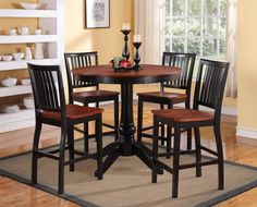 Sunbury Collection Counter Height 5 Pc Dinning Table Set(Table, 4 Chairs)Classic styles merge to create the charming Sunbury Collection. The turned table base and coordinating chairs are offered in black featuring a contrasting medium cherry finished tabletop and seats -these color combinations allow for easy placement in a variety of casual dining spaces. The five-piece collection will be a welcome addition to your homeFinish:BLACK finishDimensions:Table:42 RD x 36HChairs:18 X 21X 40H