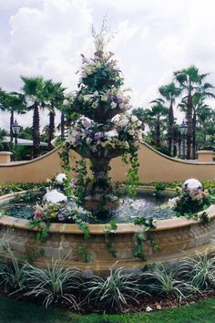 Glorious fountain flowers for a wedding ceremony on the Grand Lawn at the Wyndham Hotel, designed by Lana with Fairbanks Florist.  Sterling Photography International.