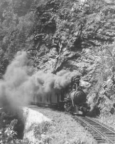 Tweetsie (East Tennessee & Western North Carolina Railroad train No. 11) in the Doe River Gorge, smoke billowing from its smokestack. Date:...7/18/1940