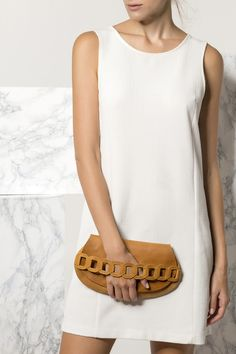 Carry your essentials in style with the Iro design clutch in camel. Handmade of fine quality waxed nubuck leather features our signature chain handle. White Clutch Bags, Leather Clutch Bags, Handmade Clutch, Leather Bags Handmade, Evening Bags, Essentials, Athens Greece, Black White, Women's Bags