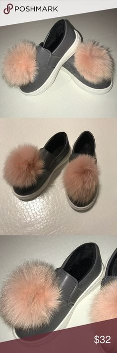 Adorable Girls Sneakers These trendy sneakers are the perfect kicks for your little girl! With a big pink Pom Pom, these shoes are everything a girl can hope for! They're fleece lined to keep her feet extra warm. They are brand new and never used. Shoes Sneakers
