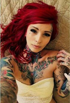 Love the hair color. love the tattoos. love the dermal piercings. Cant wait to do mine.