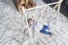 Learn how to make a wooden baby gym with this helpful step by step guide Baby Play, Baby Toys, Baby Diy Projects, Wood Projects, Diy Baby Gym, Baby Learning Activities, Play Gym, Baby Swings, Baby Fever
