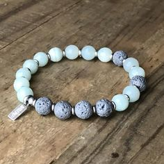 Essential Oil Diffuser Bracelet made with amazonite and titanium coated lava. #diffuserbracelet