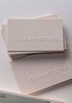 Card Design Discover Blind embossed business cards printed by Jot Paper Co. for Opahstore. Blind embossed business cards printed by Jot Paper Co. for Opahstore. on GFSmith Extract Moon Stationery Design, Branding Design, Logo Design, Design Design, Identity Branding, Graphic Design, Brochure Design, Visual Identity, Cover Design