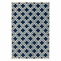 Wool rug with a quatrefoil ogee motif. Made in India. Product: RugConstruction Material: WoolColor: Dark blue and ivory    Features: Made in India Note: Please be aware that actual colors may vary from those shown on your screen. Accent rugs may also not show the entire pattern that the corresponding area rugs have.