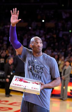 Los Angeles Lakers' Kobe Bryant waves to fans after receiving his NBA All-Star Game jersey prior to the team's basketball game against the Minnesota Timberwolves, Tuesday, Feb. 2, 2016, in Los Angeles.